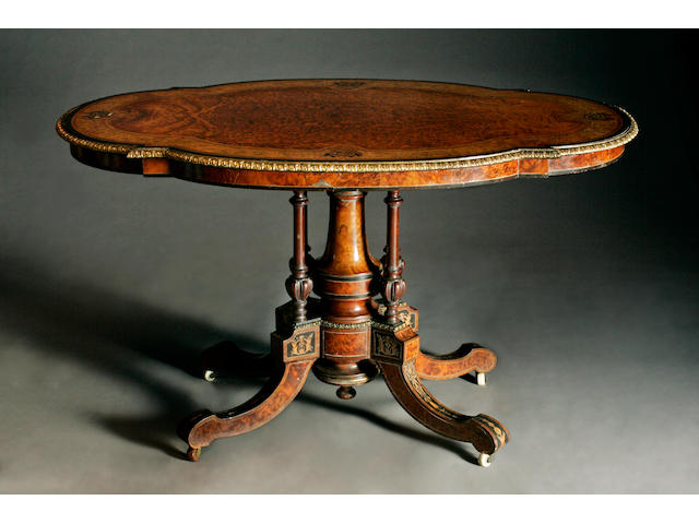 A mid Victorian amboyna, thuya and ebonised centre table