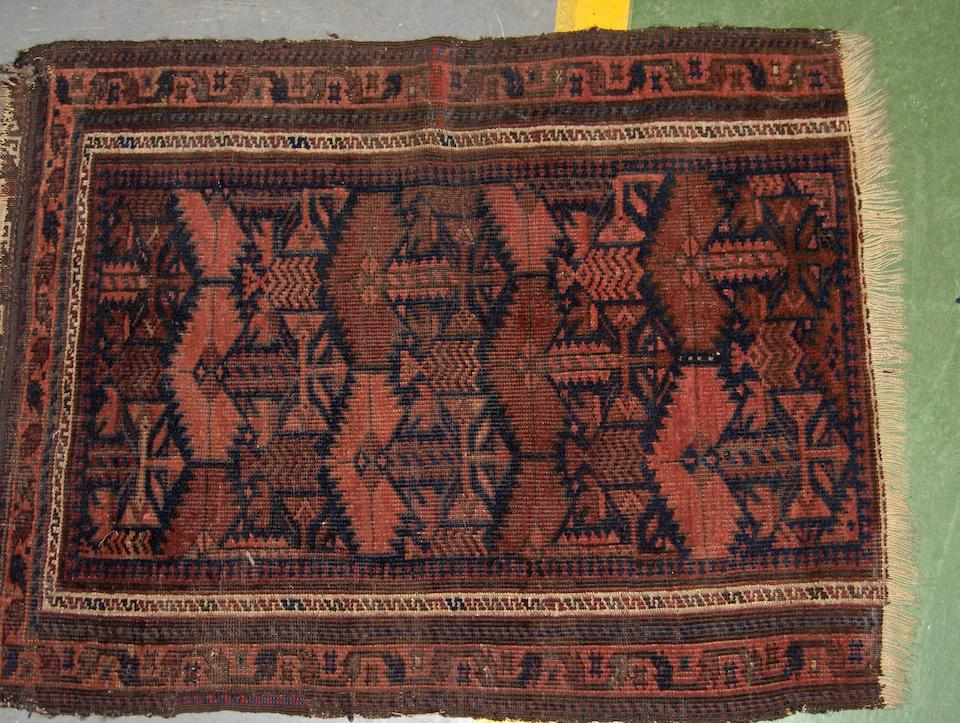 A Beshir chuval together with four rugs (5)