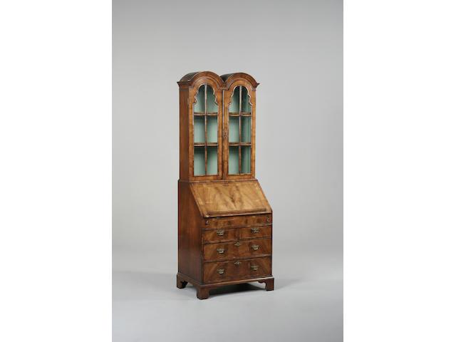 A Queen Anne style walnut bureau bookcase