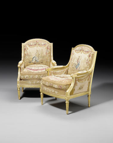 A pair of late 19th century carved giltwood Bergeres by Jeanselme Fils et Godin Et Cie, in the Louis XVI taste