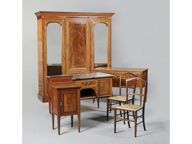 A late Edwardian mahogany and satinwood banded bedroom suite