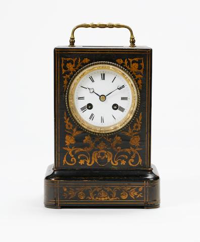 A mid 19th century French ebony and boxwood inlaid mantel clock Paul Garnier, Paris-