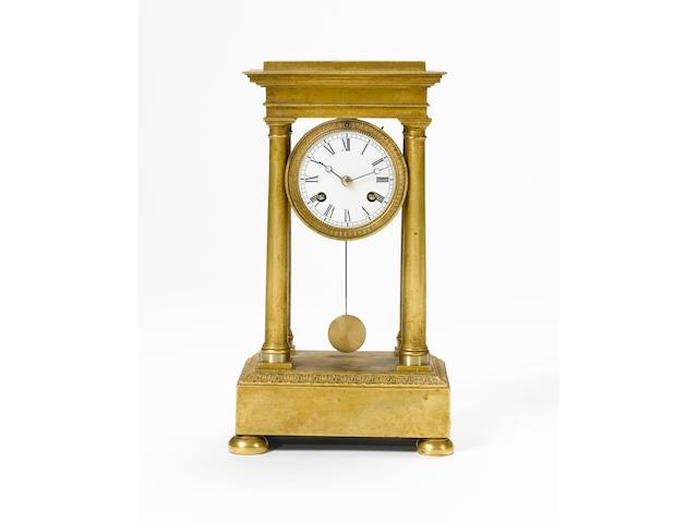 A late 19th Century miniature portico clock,