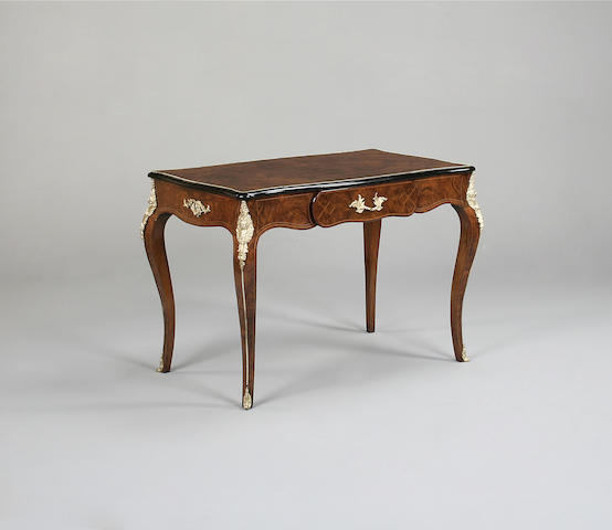 A Louis XV style walnut and gilt mounted bureau plat stamped FROM GEOREEDWOOD'S FURNITURE WAREHOUSE,