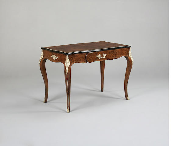 A Louis XV style walnut and gilt mounted  bureau plat