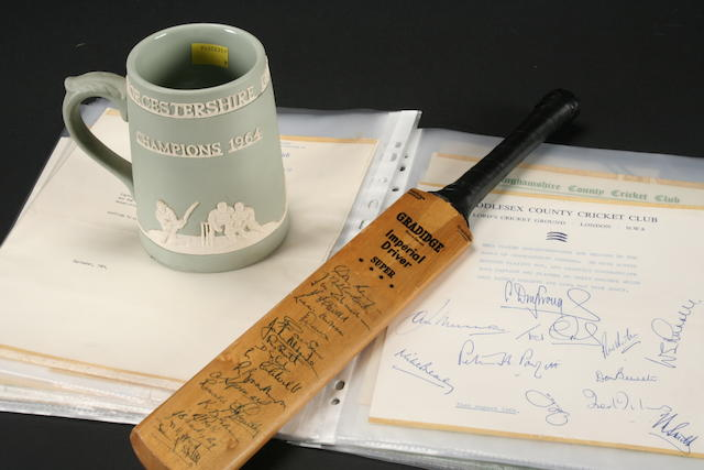 A signed Worcestershire miniature cricket bat