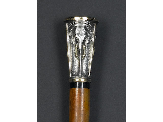 An early 20th century Continental silver, gilt and ivory mounted elephant motif cane, unmarked,