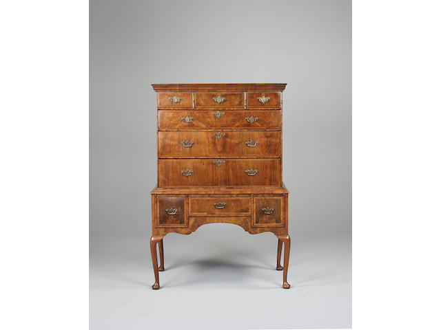 An early 18th century walnut chest on stand