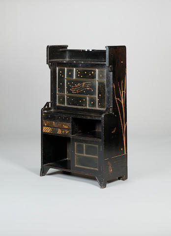 An ebonised and parcel gilt secretaire writing cabinet