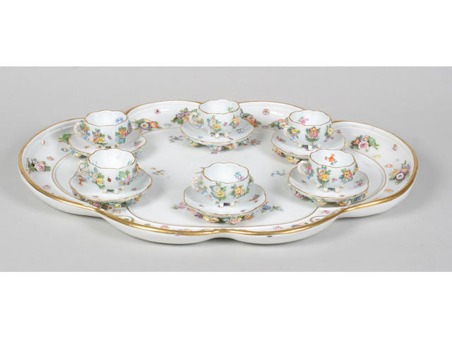 A set of twelve Meissen floral encrusted cabinet cups and saucers