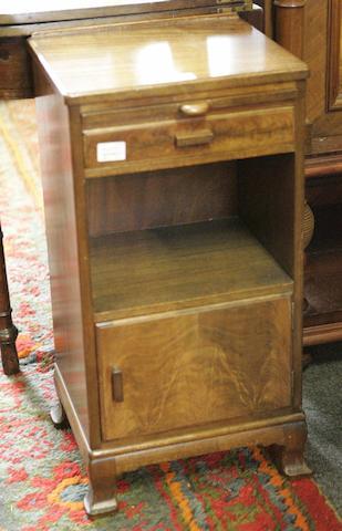 A Whytock & Reid walnut bedside cupboard