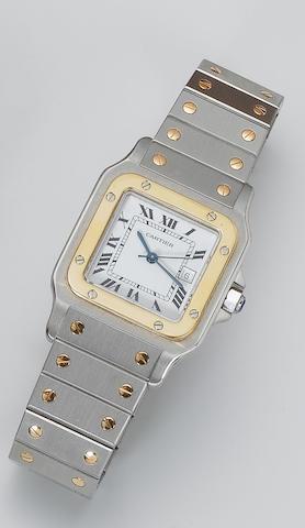 Cartier. A stainless steel and gold calendar wristwatch Santos, recent