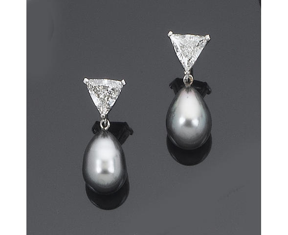 A pair of diamond and cultured pearl pendent earrings