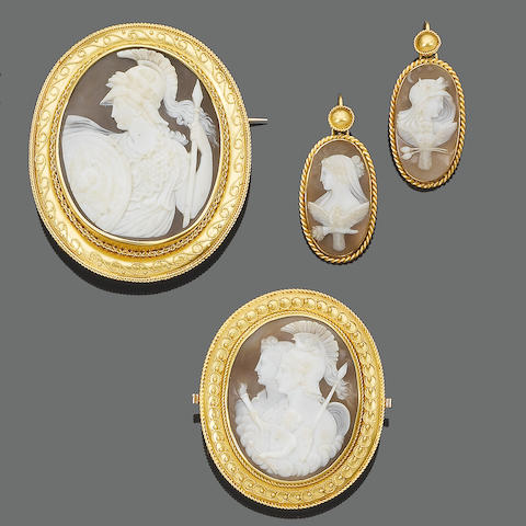 A matched set of three 19th century shell cameo brooches and a pair of shell cameo pendant earrings,