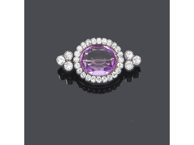 An early 20th century pink topaz and diamond brooch,