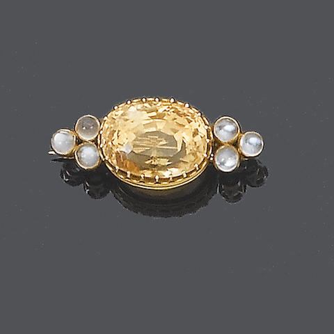 A late 19th century yellow sapphire and moonstone brooch,