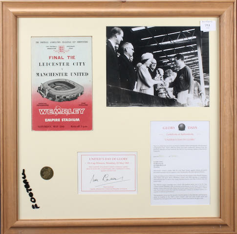 """""""United Days of Glory"""", a signed montage Monochrome photograph of Noel Cantwell collecting the F.A. Cup from the Queen, following Manchester United 3-1 victory over Leicester in the 1963 Final.  Mounted along with Replica F.A. Cup Final medal, programme of the game and special Days of Glory.  Hand signed by Cantwell.  Framed and glazed with COA. 58cm x 58cm."""