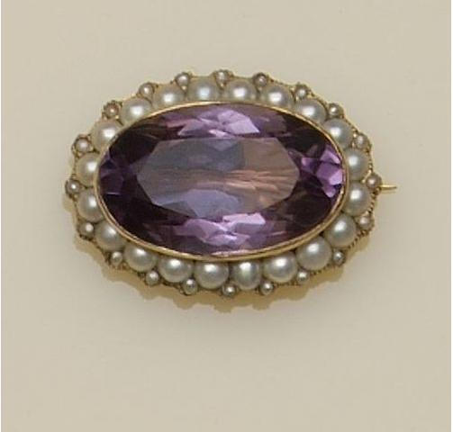 An oval amethyst and half pearl cluster brooch,