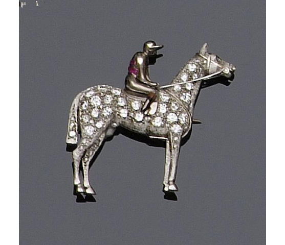 A diamond set horse and jockey brooch