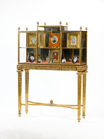 A Portrait Miniature Display Cabinet by H. J. Hatfield & Son, the stepped glazed ormolu cabinet with