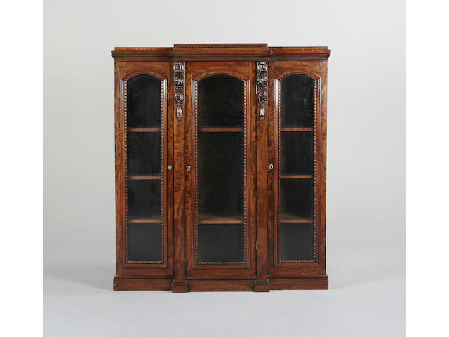 A late Victorian carved mahogany breakfront bookcase