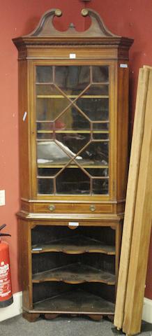 An Edwardian mahogany and boxwood strung two part corner cabinet