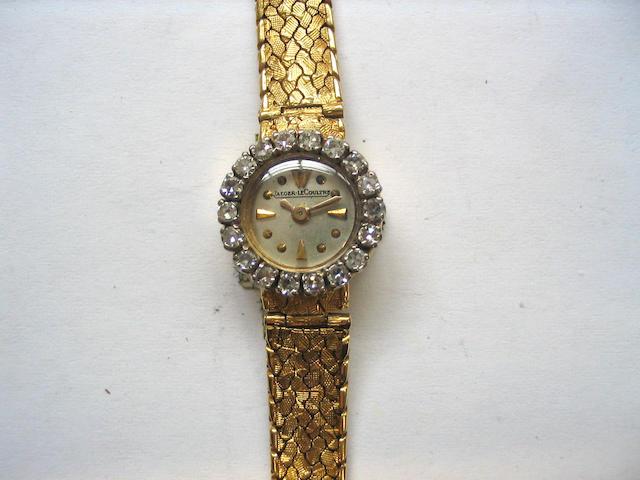 Jaeger Le Coultre. A lady's 18ct gold diamond set bracelet watch
