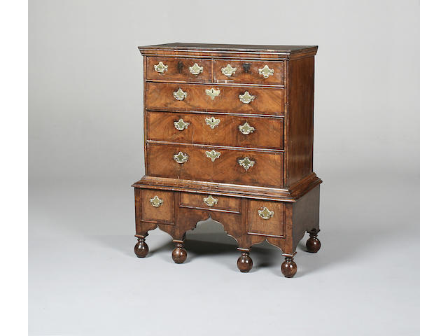 A late 17th century and later walnut and mahogany crossbanded chest on stand