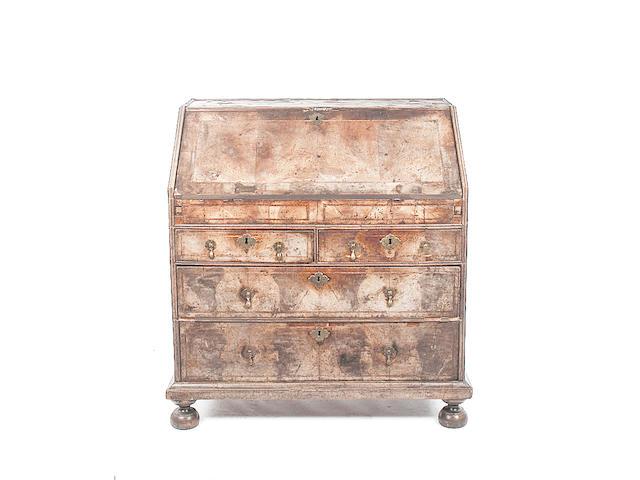 A mid 18th century walnut veneered bureau,