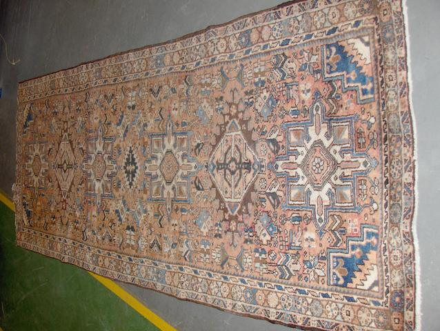 A Heriz runner North West Persia, 271cm x 116cm
