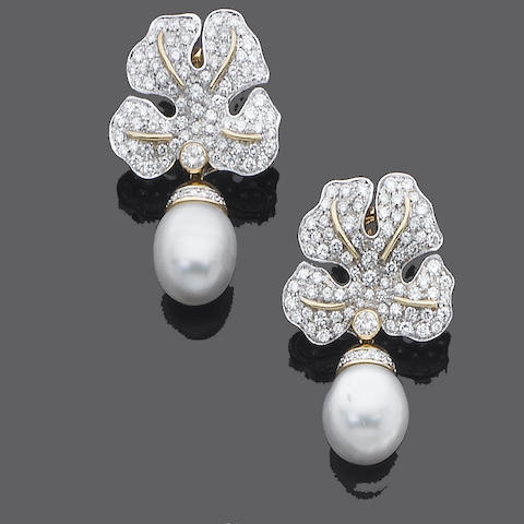 A pair of diamond and cultured pearl earrings