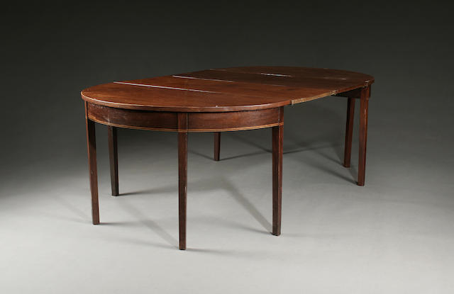 An early 19th Century mahogany D-end dining table