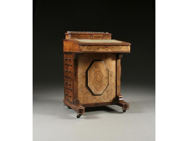 A mid Victorian inlaid figured walnut davenport
