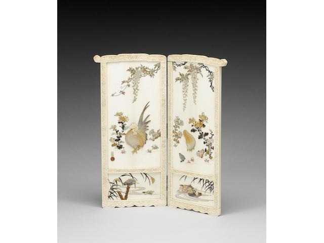An elegant ivory two-leaf screen;