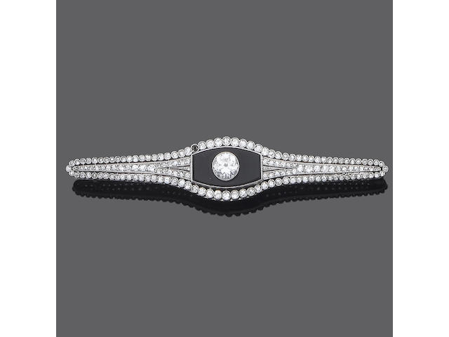 An art deco diamond and onyx bar brooch,