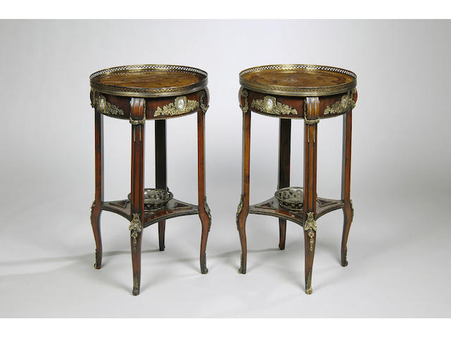 A pair of French transitional style walnut and inlaid gilt metal mounted table ambulantes