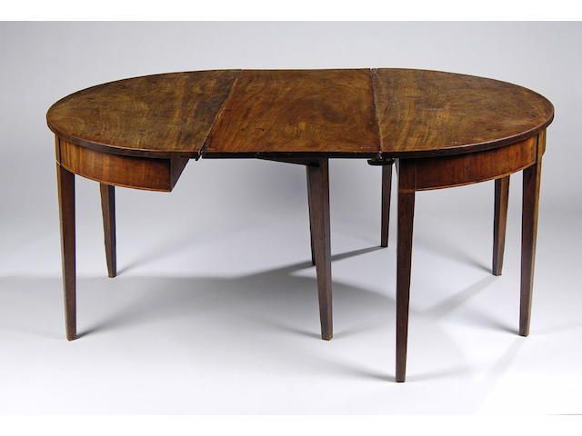 An early 19th Century D-end dining table
