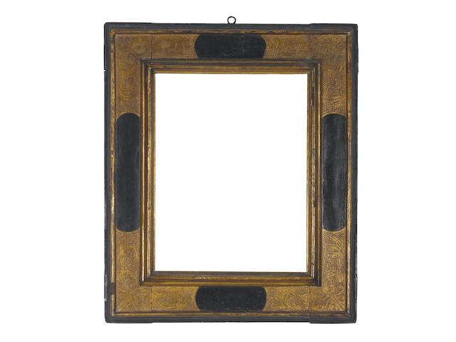 A Spanish 17th Century parcel-gilt and black painted cassetta frame