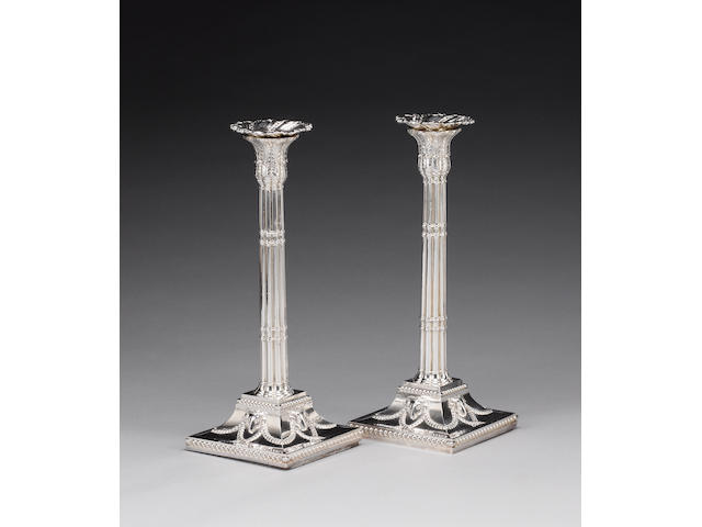 A pair of George III silver candlesticks, by Henry Tudor & Thomas Leader, Sheffield 1777, sconces st