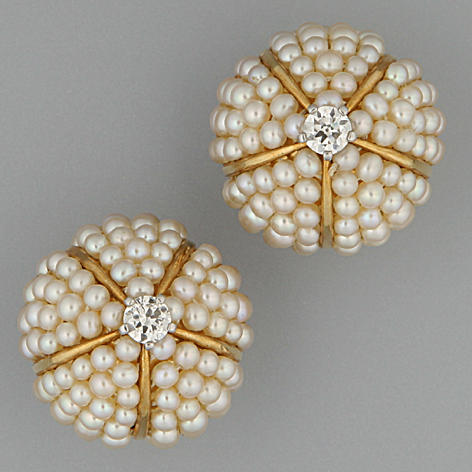 Cartier, Paris.  A pair of diamond and pearl bombé earclips