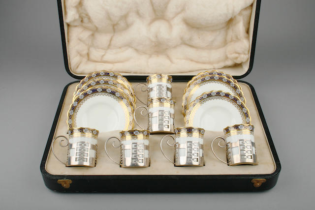 A cased silver mounted six piece coffee set the mounts by Walker & Hall, Sheffield 1920,