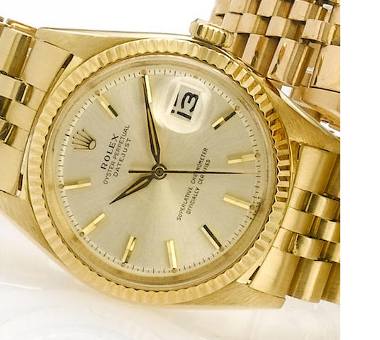 Rolex. An 18ct gold automatic calendar bracelet watch with original papers  Datejust, Ref:1601, Sold June 1966