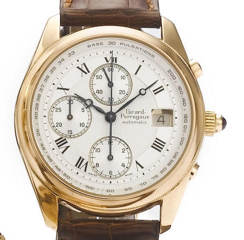 Girard Perregaux. An 18ct gold automatic calendar chronograph watch with box and papers   Model No.49201, recent
