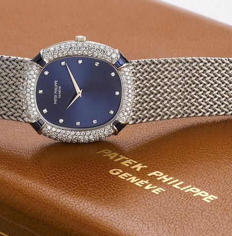 Patek Philippe. A fine and rare 18ct white gold automatic bracelet watch set with diamonds and sapphires, together with its Patek Philippe fitted watch/jewellery box and original Certificate of Origin Ref:3609/3, Case No.2758735, Movement No.1287317, Made in 1976 and Sold on the 21st of July 1977