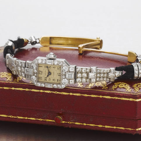 Cartier. A fine and very rare platinum and diamond set wristwatch with Cartier fitted presentation box  Case No.5165, 1920's
