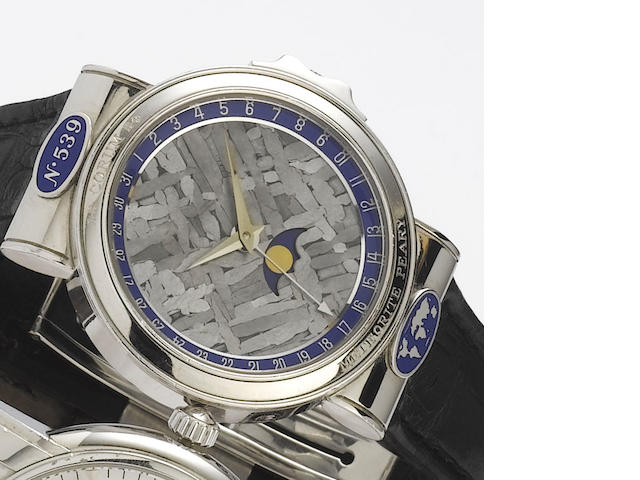 Corum. A fine and rare automatic platinum wristwatch with date and moon phases  Meteorite Peary, No.539, Ref.61.450.70, 1990's