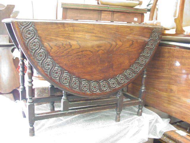 A late 18th century oak gateleg dining table,