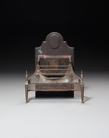 A late 19th century steel and cast iron fire grate in the George III style,