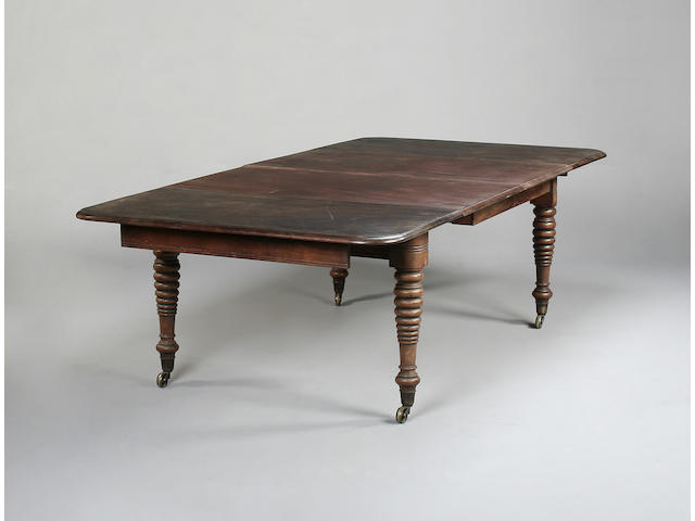 A Victorian mahogany dining table