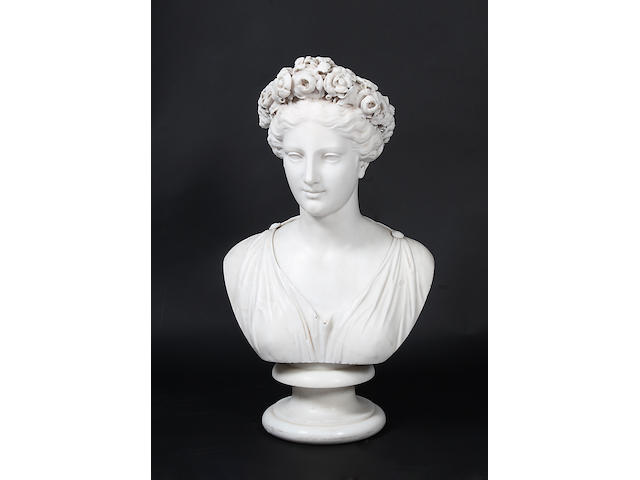 A 19th century marble bust of a young woman